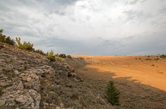 在日落的阴影在普莱尔山的Tillett里奇俯视的茶杯峡谷在蒙大拿美国 免版税库存图片