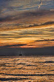 在日落的风船在距离 免版税库存照片