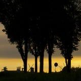 在日落的风车 图库摄影