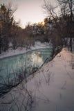 在日落的冻小河 库存照片