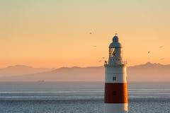 在日落的直布罗陀灯塔 库存照片