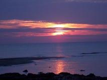 在日落的紫色天空 免版税图库摄影
