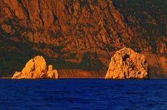 在日落的Adalary岩石 库存图片