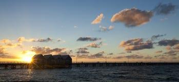 在日落的Busselton跳船 库存图片