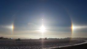 在日落的Sundog光晕在冬天 库存图片