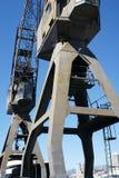 在旧港口的两台起重机 库存图片