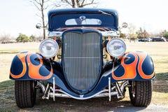 在旧车改装的高速马力汽车的俏丽的油漆工作 免版税库存照片