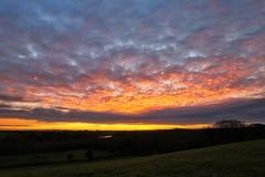 在早晨日出的红色天空 免版税图库摄影