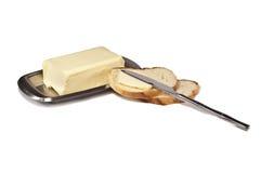 在早餐黄油上添面包 免版税库存照片