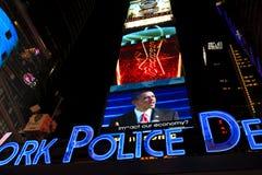 在时代广场屏幕的Barack Obama  免版税库存照片