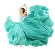 在时尚礼服,挥动在风的织品布料的妇女跳舞 库存图片