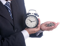 在时间和货币之间的选择 免版税库存图片