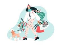 在时髦外衣打扮的微笑的年轻女人遛她的在皮带的狮子狗和运载与购买的袋子 皇族释放例证