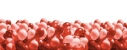在时髦生存珊瑚颜色的气球 库存照片