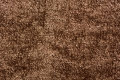 在时髦的棕色颜色的侈奢的纺织品背景 免版税库存照片