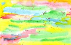在明亮的彩虹颜色的手画抽象水彩 免版税库存图片