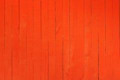 在明亮的红颜色绘的木墙壁的背景图象 库存照片
