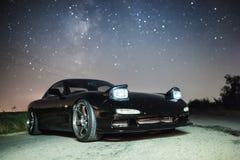 在星下的汽车 免版税库存照片