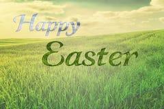 在春天自然本底的愉快的复活节字法书法 免版税库存照片