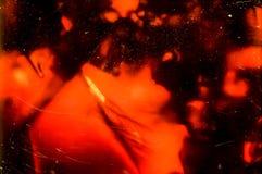在显微镜的历史的玻璃检查有在35mm苏维埃Orwochrom影片的照片的以manny瑕疵 免版税库存照片