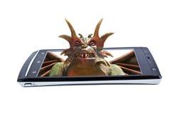 在显示智能手机的撒旦 拼贴画 免版税库存图片