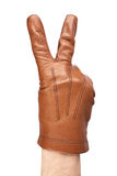 在显示胜利标志的手套的人的手 库存照片