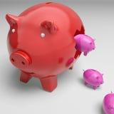在显示金钱成长的Piggybank里面的Piggybanks 免版税库存照片