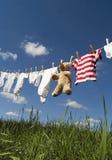 在晒衣绳的婴孩衣物 免版税图库摄影