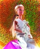 在晚礼服的玩具玩偶 免版税图库摄影