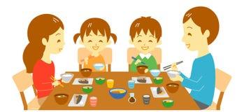 在晚餐,日本膳食的年轻家庭 向量例证