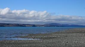 在普卡基湖的云彩 免版税库存图片