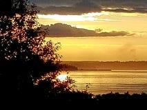 在普吉特海湾的日落 库存图片