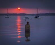 在普尔港的日落Hamworthy码头的 免版税库存图片