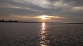 在景气海滩的日落 库存照片