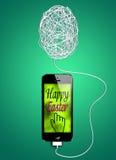在智能手机的复活节问候 免版税库存照片