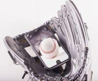 在智能手机的棒球在棒球手套 免版税库存图片