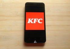 在智能手机的肯德基应用程序 库存图片