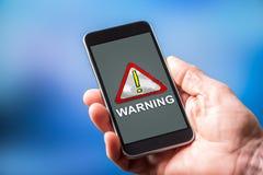 在智能手机的警告的概念 免版税库存图片