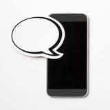 在智能手机的讲话泡影 库存图片