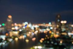 在暮色时间,被弄脏的照片bokeh的曼谷都市风景 库存照片