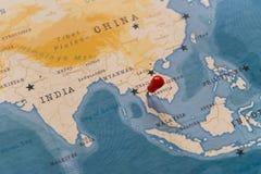 在曼谷,世界地图的泰国的一个别针 免版税库存图片