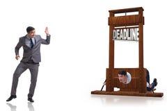 在最后期限概念的商人与断头台 免版税库存照片