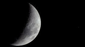 在月亮和土星之间的接近的遭遇 免版税库存照片