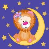 在月亮的逗人喜爱的狮子 库存图片