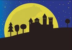 在月亮背景的城堡 图库摄影