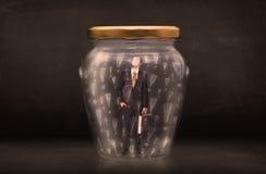 在有惊叹号概念的瓶子困住的商人 图库摄影