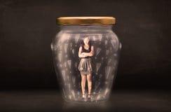在有惊叹号概念的瓶子困住的女商人 免版税图库摄影