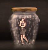 在有惊叹号概念的瓶子困住的女商人 免版税库存图片