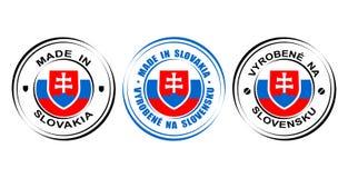 在有旗子和徽章的斯洛伐克制造的圆的标签 库存照片