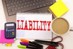 在有膝上型计算机的,标志,笔,文具,咖啡办公室措辞文字责任 责任的法律Blam企业概念 免版税库存图片